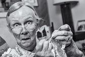 Surprised woman crocheting — Stock Photo