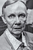 Old lady looks harshly — Stock Photo