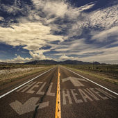 Road with arrows to heaven and hell — Stock Photo
