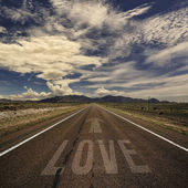 Desert road with the word love — Stock Photo