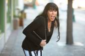 Woman on a downtown street yelling — Stock Photo