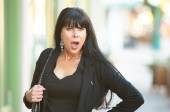 Woman on a downtown street looking shocked — Stock Photo