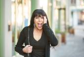 Surprised woman on a downtown street — Stock Photo