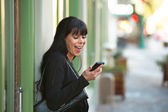 Woman looking at her cellphone — Stock Photo
