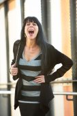 Woman in striped dress laughing — Stock Photo