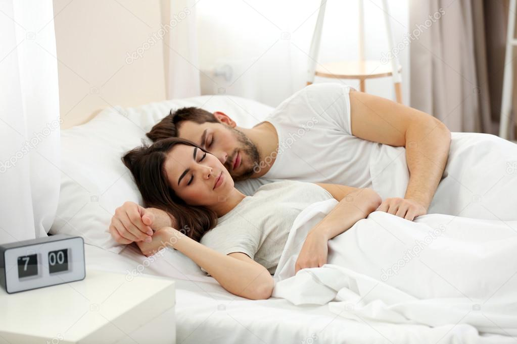 young cute couple sleeping together in bed stock photo belchonock 104358912. Black Bedroom Furniture Sets. Home Design Ideas
