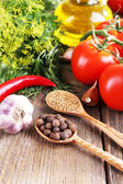 Fresh vegetables with herbs and spices on table, close-up — Foto Stock