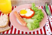 Scrambled eggs with sausage, lettuce and juice served on tray — Stock Photo