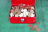Rectangular red open suitcase with Ukrainian coins on wooden table — Stock Photo