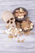 Black round plates full of Ukrainian coins on wooden table — Stock Photo