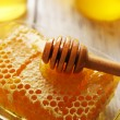Honeycomb on wooden table — Stock Photo #51906547