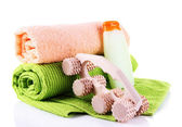 Wooden roller brush, towels and shampoo on white background isolated — Stockfoto