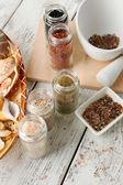 Different sea salt on wooden table, close up — Stock Photo