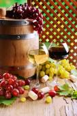 Wine with grapes on table on brown background — Stock Photo