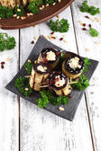 Fried aubergine with cottage cheese and parsley on wooden background — Stock Photo