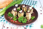 Fried aubergine with cottage cheese, parsley and bread on wooden background — Stock Photo