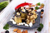 Fried aubergine with cottage cheese in a square plate on wooden background — Stock Photo