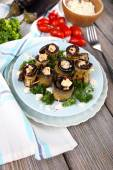 Fried aubergine with cottage cheese in a round plate on wooden background — Stock Photo