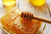 Honeycomb on wooden table — Stock Photo