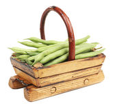 French beans in wooden basket isolated on white — Stock Photo
