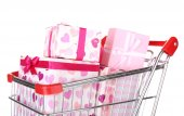 Many present boxes in shopping cart isolated on white — Foto Stock