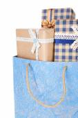Present boxes in paper bag isolated on white — Stock Photo