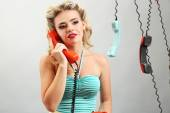 Girl with old telephone — Stock Photo