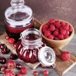 Berries jam in glass jars on table, close-up — Stock Photo #52093461