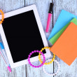 Tablet, bracelet, notebook and pen on wooden background — Stock Photo #52096957