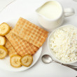 Delicious breakfast with milk, cookies and cottage cheese — Stock Photo #52098417
