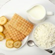 Delicious breakfast with milk, cookies and cottage cheese — Stock Photo #52098425