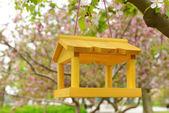 Wooden Birdhouse in garden — Stock Photo