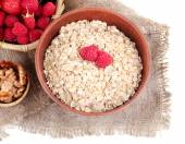 Wooden bowls of berries on sackcloth isolated on white — Stockfoto