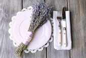 Dining table setting with lavender flowers on wooden table background — Stock Photo