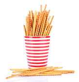 Sticks in red cups on white background isolated — Stockfoto