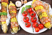 Grilled bacon wrapped corn on table, close-up — Foto Stock