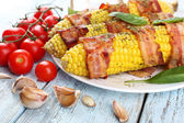 Grilled bacon wrapped corn on table, close-up — Стоковое фото