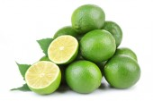 Fresh juicy limes, isolated on white — Stockfoto