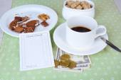 Check, cup of coffee and money on table close-up — Stock Photo