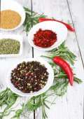 Spice with herbs and dried chilly pepper on wooden background — Stock Photo