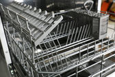 Open dishwasher without dishes in it — Stock Photo