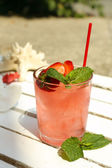 Refreshing cocktail on table, outdoors — Stock Photo