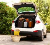 Suitcases and bags in trunk of car ready to depart for holidays — Stockfoto