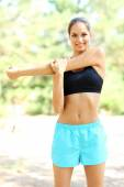 Young beautiful woman exercising outdoors — Stock Photo