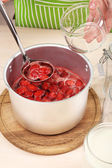 Cooking delicious strawberry jam in kitchen — Stock Photo
