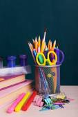 School supplies on table on board background — Stockfoto