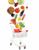 Products falling in shopping cart, isolated on white — Stock Photo