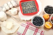Baking tasty pie and ingredients for it on table in kitchen  — Stock Photo