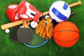 Sports equipment on grass background — Stock Photo