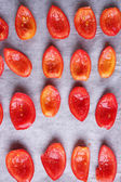 Tomatoes on drying tray, close-up — Stock Photo